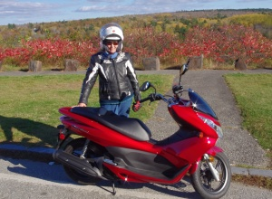 Robin in riding gear with her Honda PCX 150
